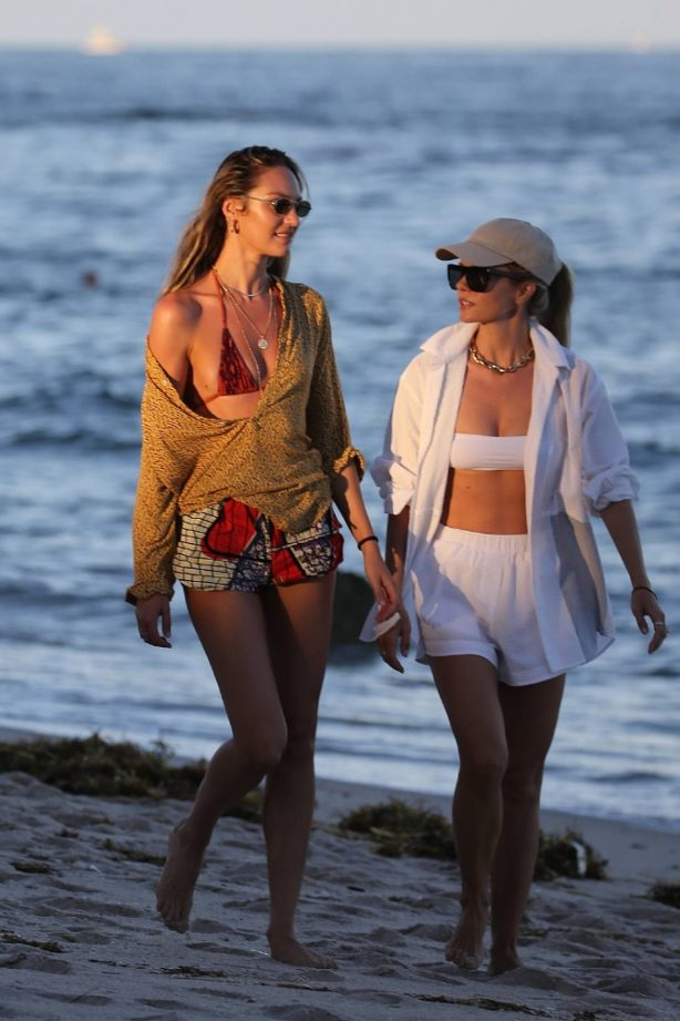 Candice Swanepoel - Stroll on the beach with a friend in Miami