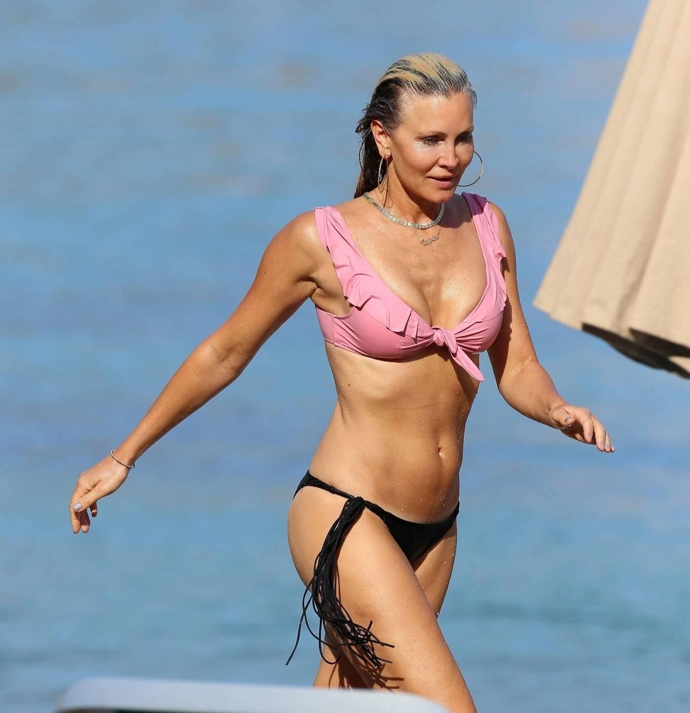 Caprice Bourret - Bikini candids at the beach in Ibiza