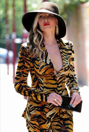Caprice Bourret in a Plunging Tiger Print Power Suit in London