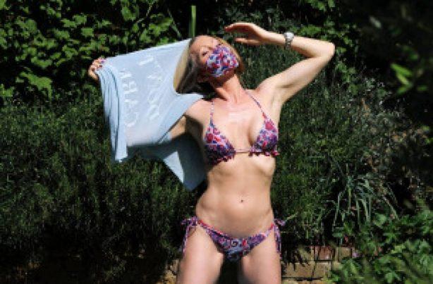Caprice Bourret in Bikini in a park in London