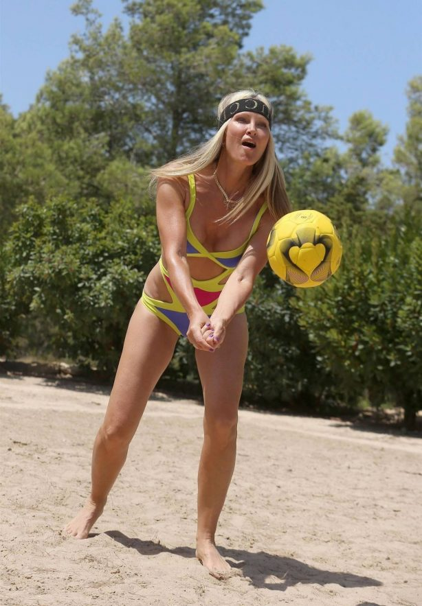 Caprice Bourret - In bikini playing volleyball on the beach in Ibiza