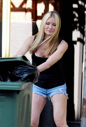 Caprice Bourret in Denim Shorts while taking out the trash in London