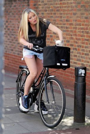Caprice Bourret - Out for a ride on her bike in London