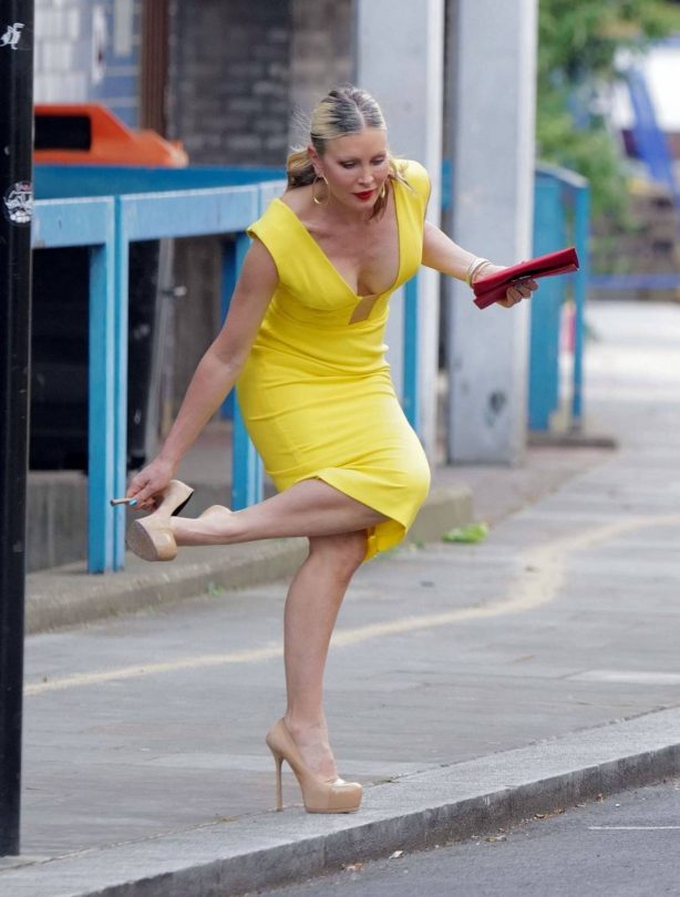 Caprice Bourret - Pictured in a tight yellow dress while out in London