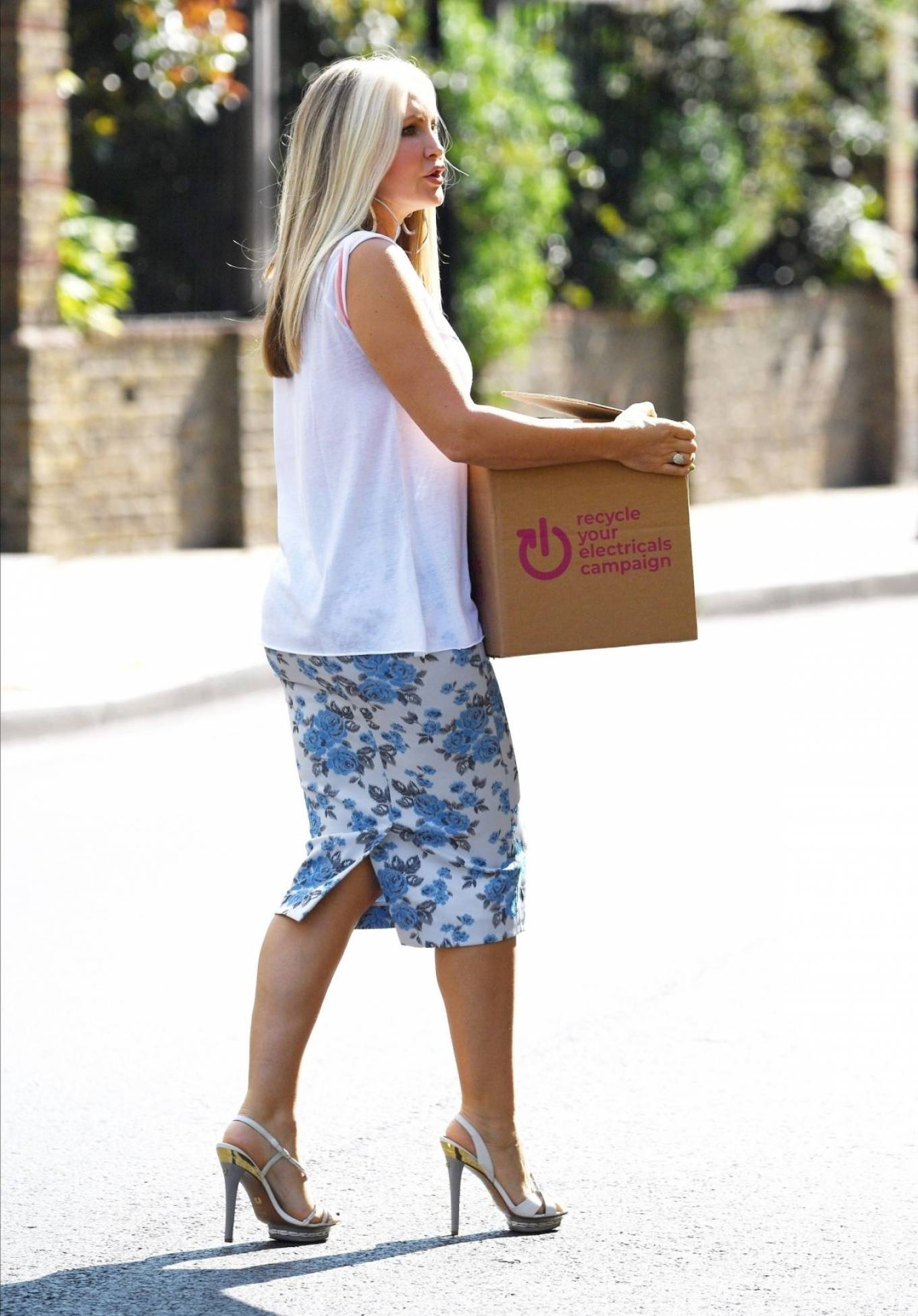 Caprice Bourret - Seen while donating Goods to Charity in Londonorum