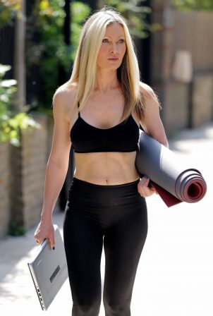 Caprice Bourret - Streaming her online yoga classes from a park in London
