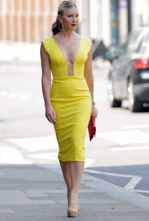 Caprice Bourret Wearing a bright plunging yellow dress - Leaving a meeting in London
