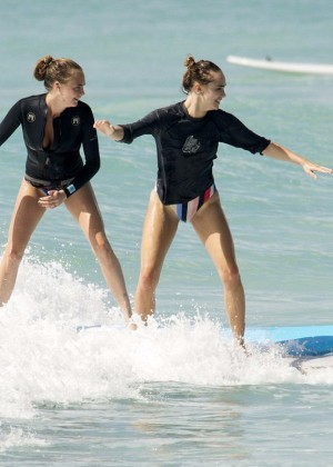 Cara Delevingne and Annie Clark Paddleboarding in Barbados