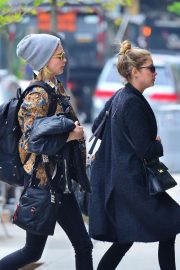 Cara Delevingne and Ashley Benson - Rush in to their new apartment in NYC