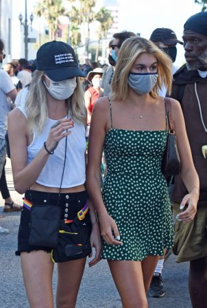 Cara Delevingne and Kaia Gerber - Showing legs while attending a BLM protest in Los Angeles