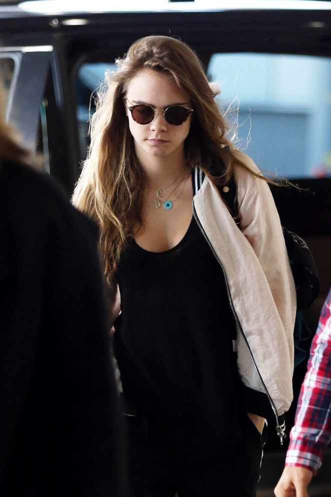 Cara Delevingne - Arrives at Airport in Sydney