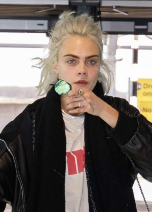Cara Delevingne arriving at Heathrow Airport in London