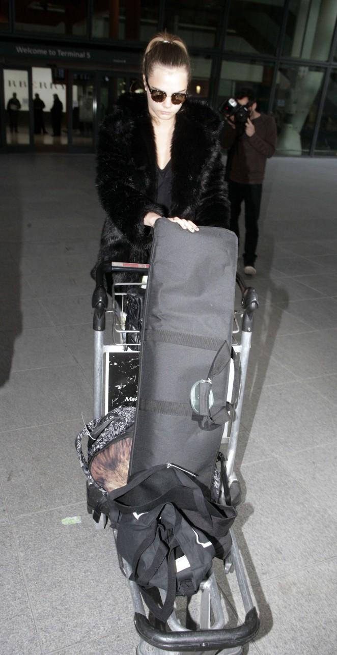 Cara Delevingne at Heathrow Airport -02