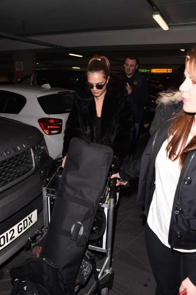 Cara Delevingne at Heathrow Airport -03