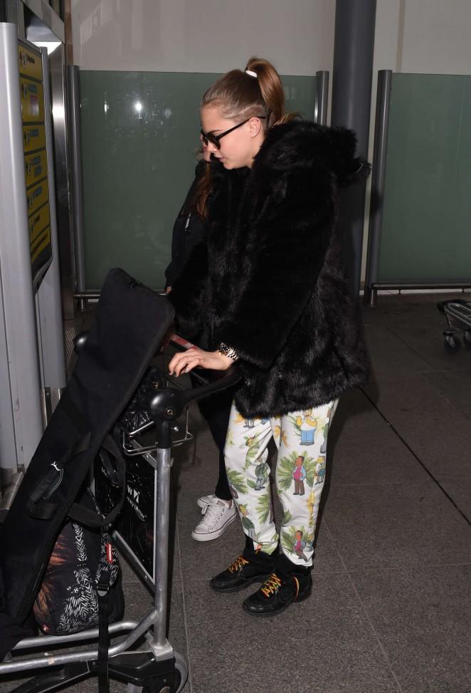 Cara Delevingne at Heathrow Airport -04