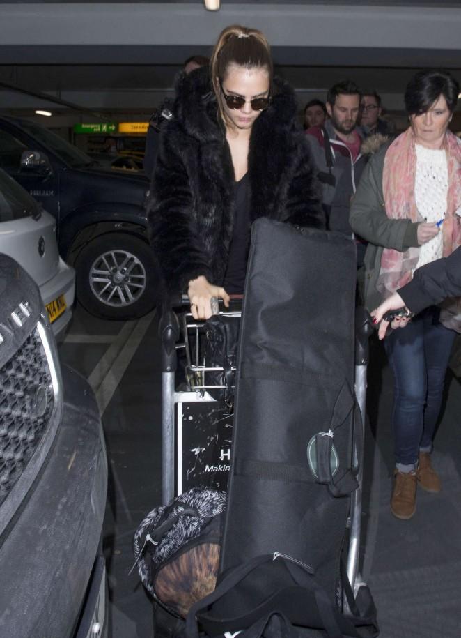 Cara Delevingne at Heathrow Airport -06