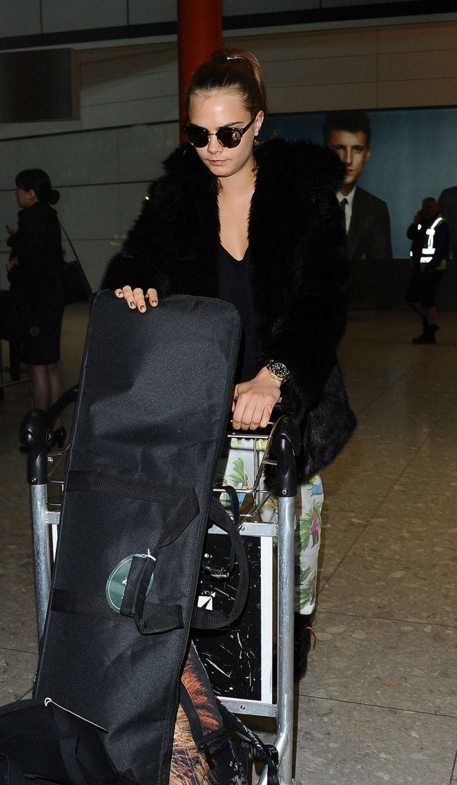 Cara Delevingne at Heathrow Airport -40