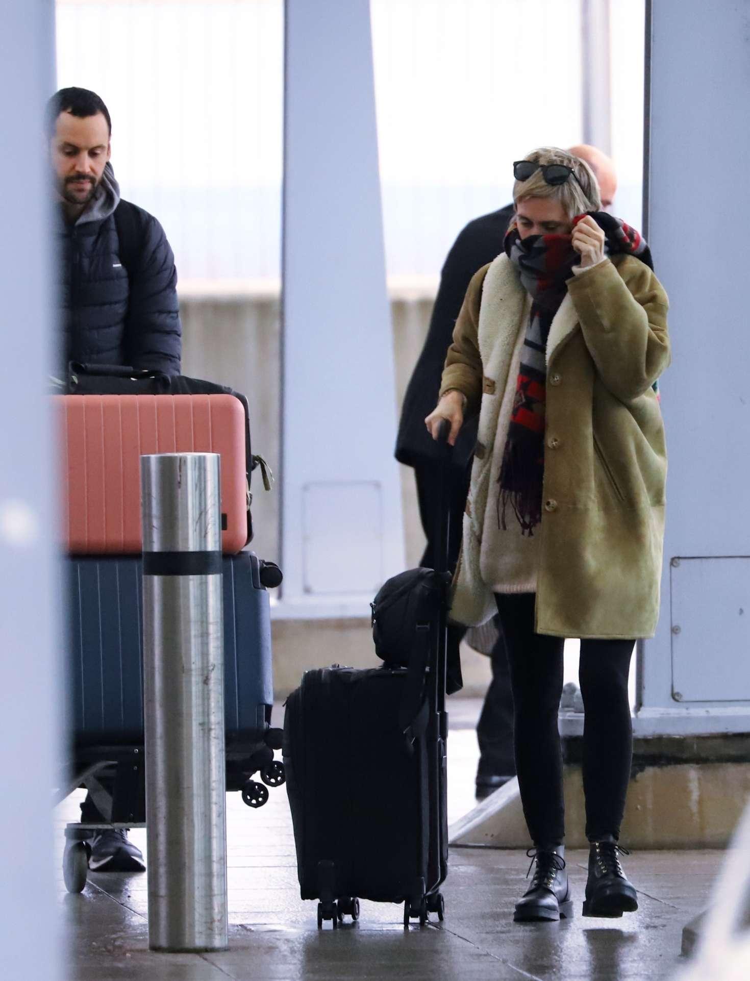 Cara Delevingne at Heathrow Airport in London