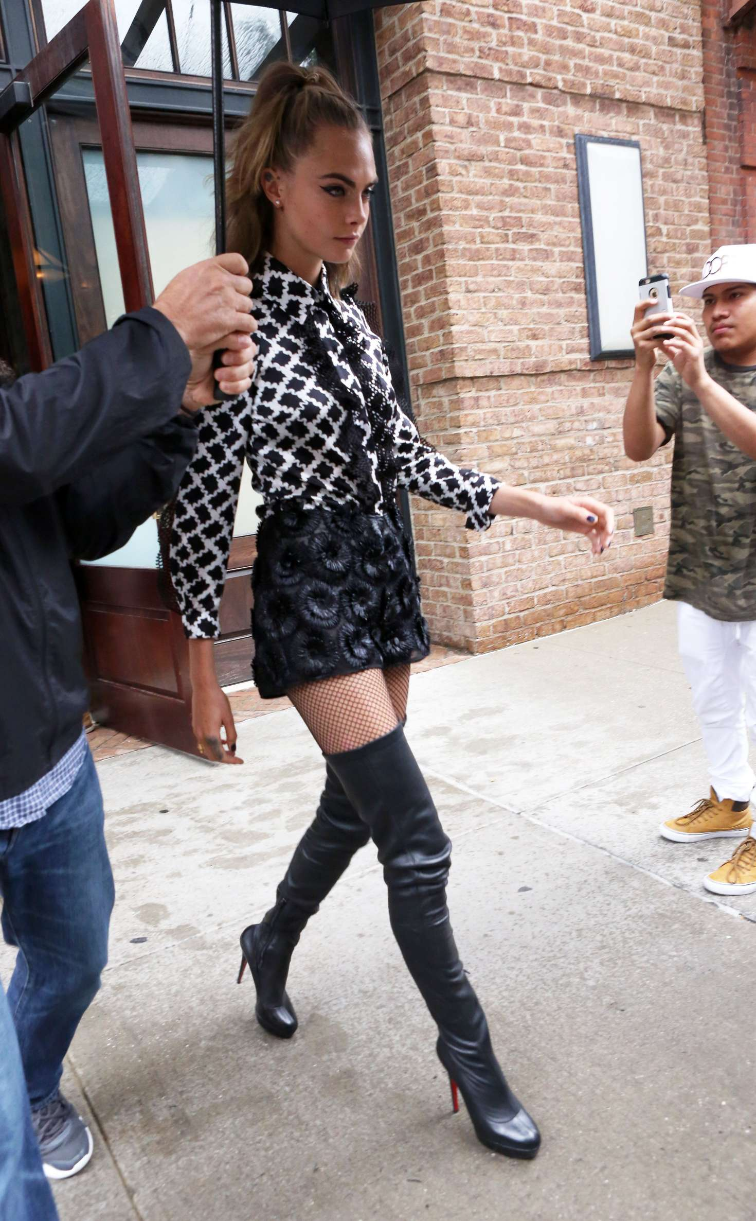 cara delevingne in thigh high boots and shorts 07