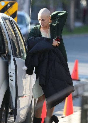 Cara Delevingne on the set of 'Life in a Year' with a shaved head in Toronto