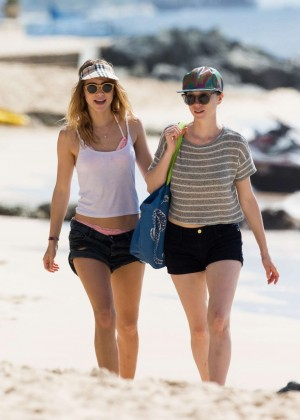 Cara Delevingne with Annie Clark and Suki Waterhouse - on the beach in Barbados