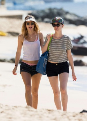 Cara Delevingne with Annie Clark and Suki Waterhouse: on the beach in Barbados-58