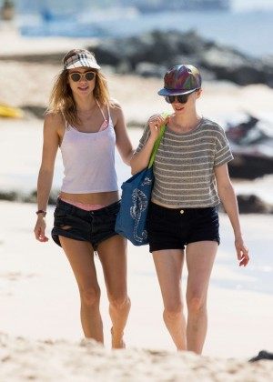 Cara Delevingne with Annie Clark and Suki Waterhouse: on the beach in Barbados-80