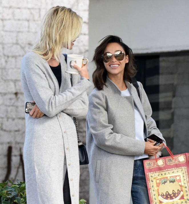 Cara Santana and Devon Windsor out on a rainy day in LA