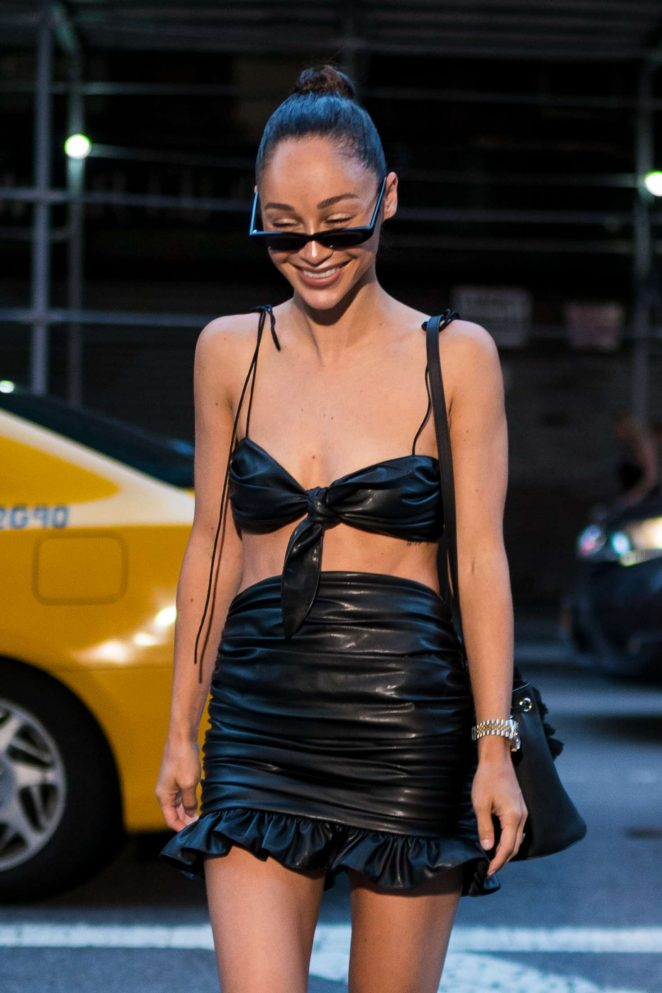 Cara Santana in Black Leather Top and Skirt in New York City