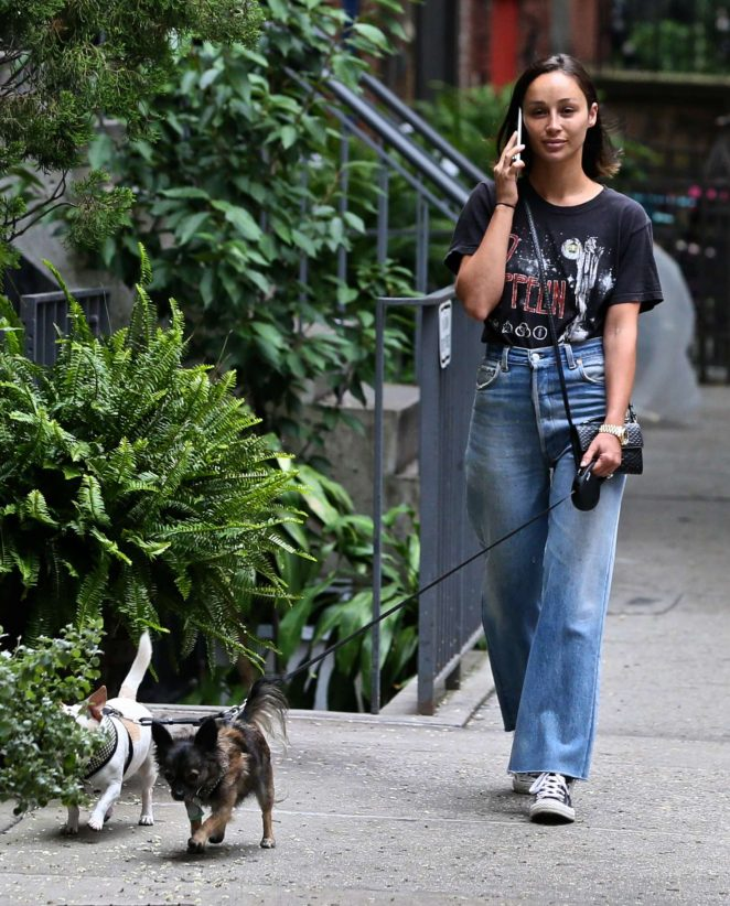 Cara Santana walking with her dogs in NYC