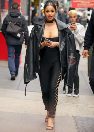 Cardi B in Black lace-up pants out in New York
