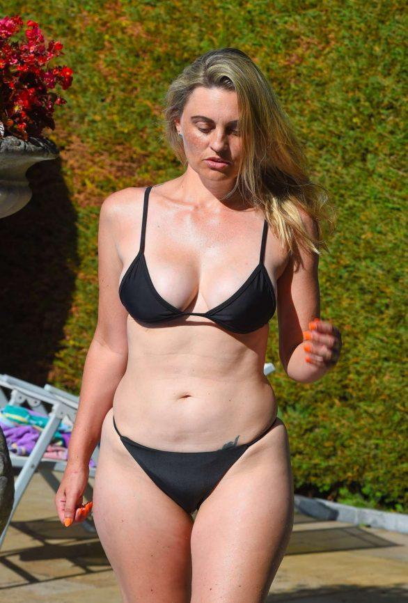 Carla Bellucci in Black Bikini at the pool in Marbella