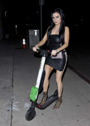 Carla Howe in Leather Mini Dress on Electric Scooter in West Hollywood