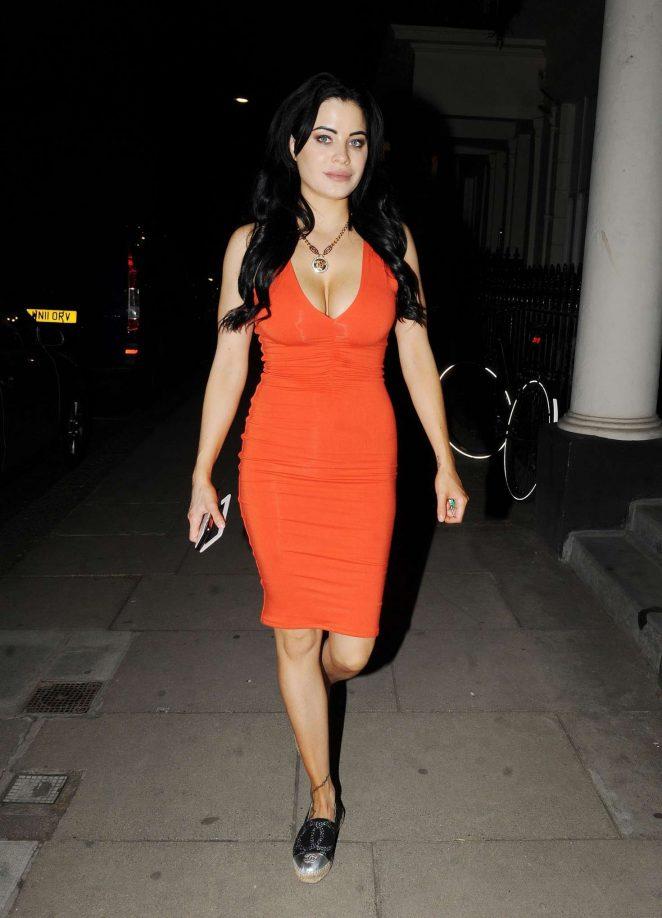 Carla Howe in Tight Orange Dress in London