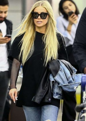 Carmen Electra in Jeans - Arrives at Airport in Miami