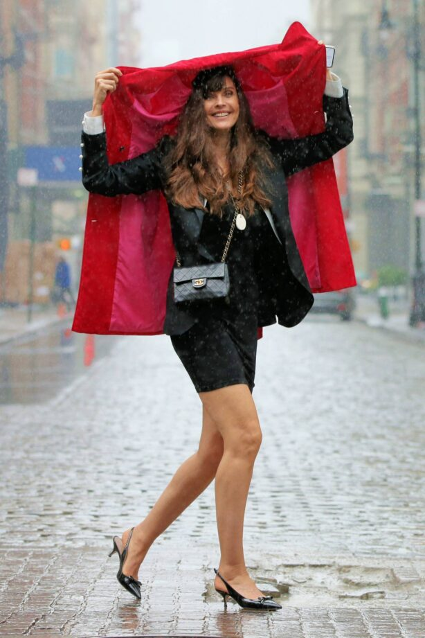 Carol Alt - Caught in the rain at Balthazar in New York