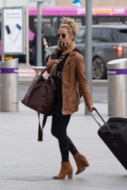 Caroline Flack flees the UK