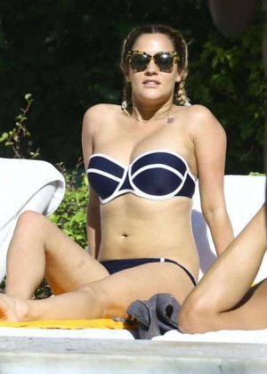 Caroline Flack in Bikini Relaxing by the pool in Miami