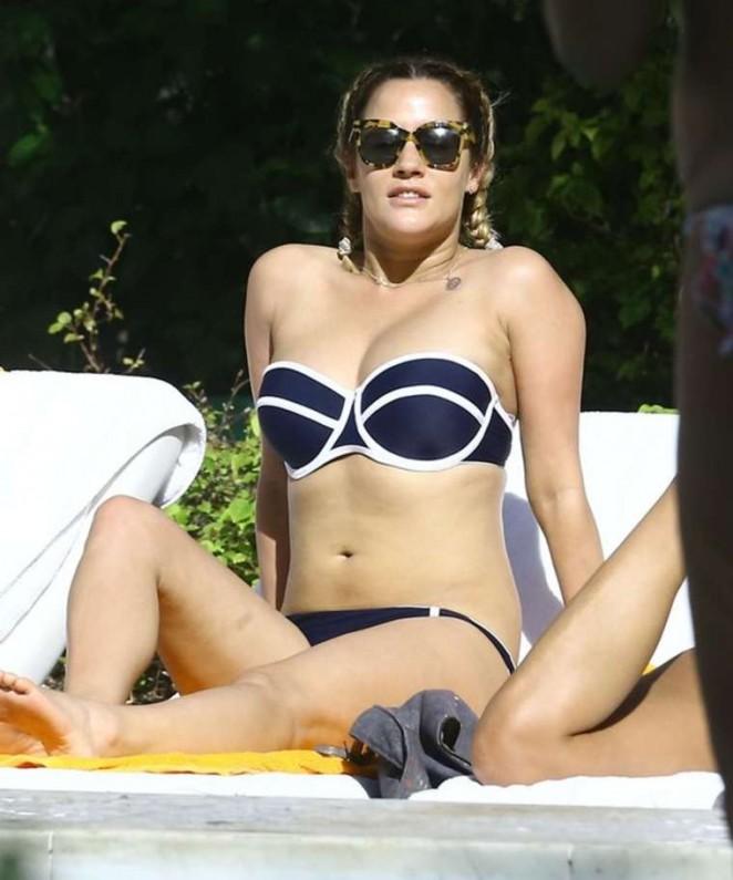 Caroline Flack in Bikini Relaxing by the pool in Miami