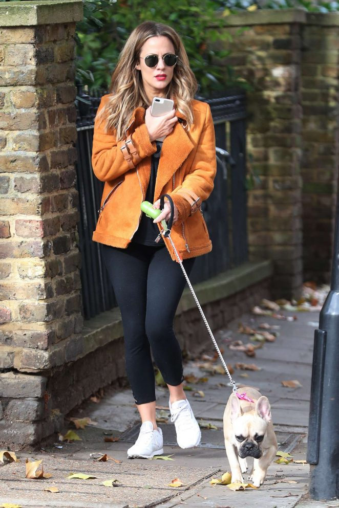 Caroline Flack with her dog out in London