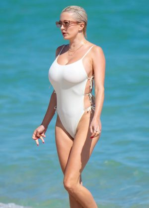 Caroline Vreeland in White Swimsuit at the beach in Miami