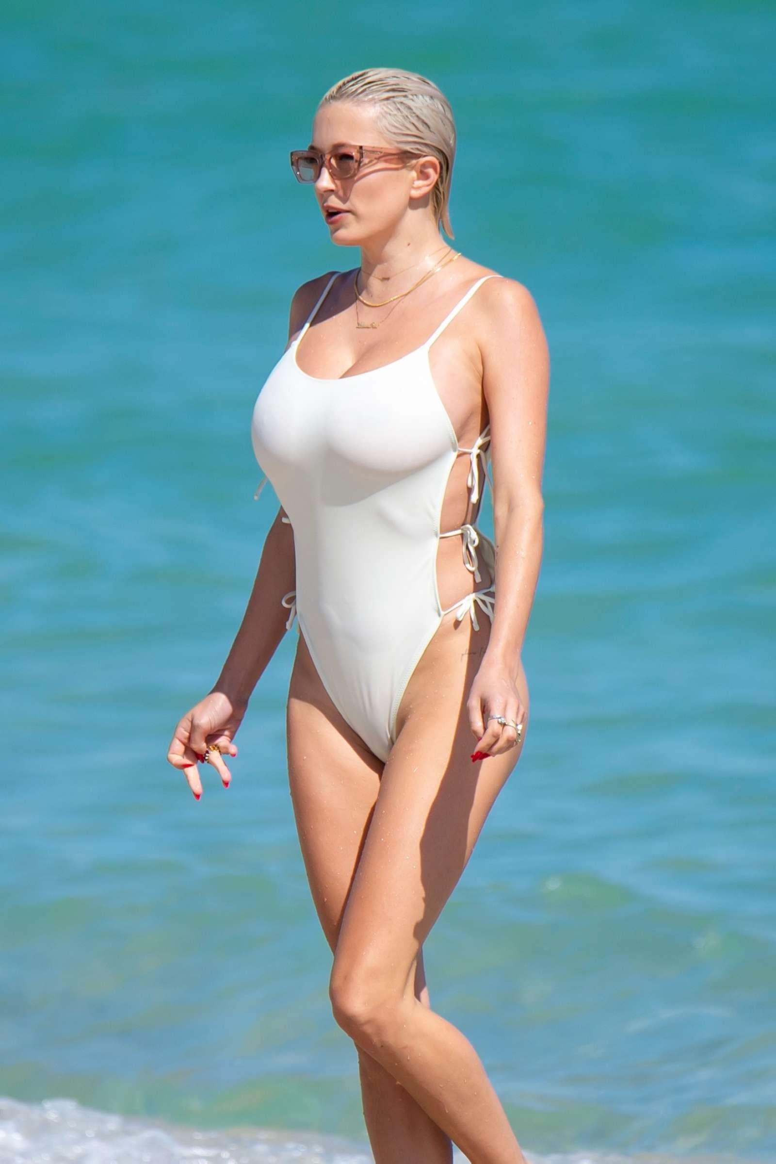 Caroline Vreeland in White Swimsuit at the beach in Miami