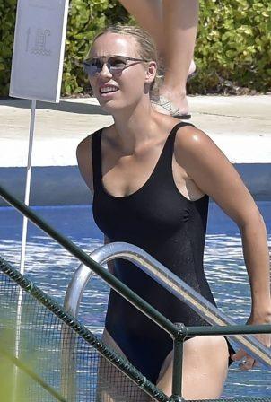 Caroline Wozniacki - In black swimsuit poolside in Portofino