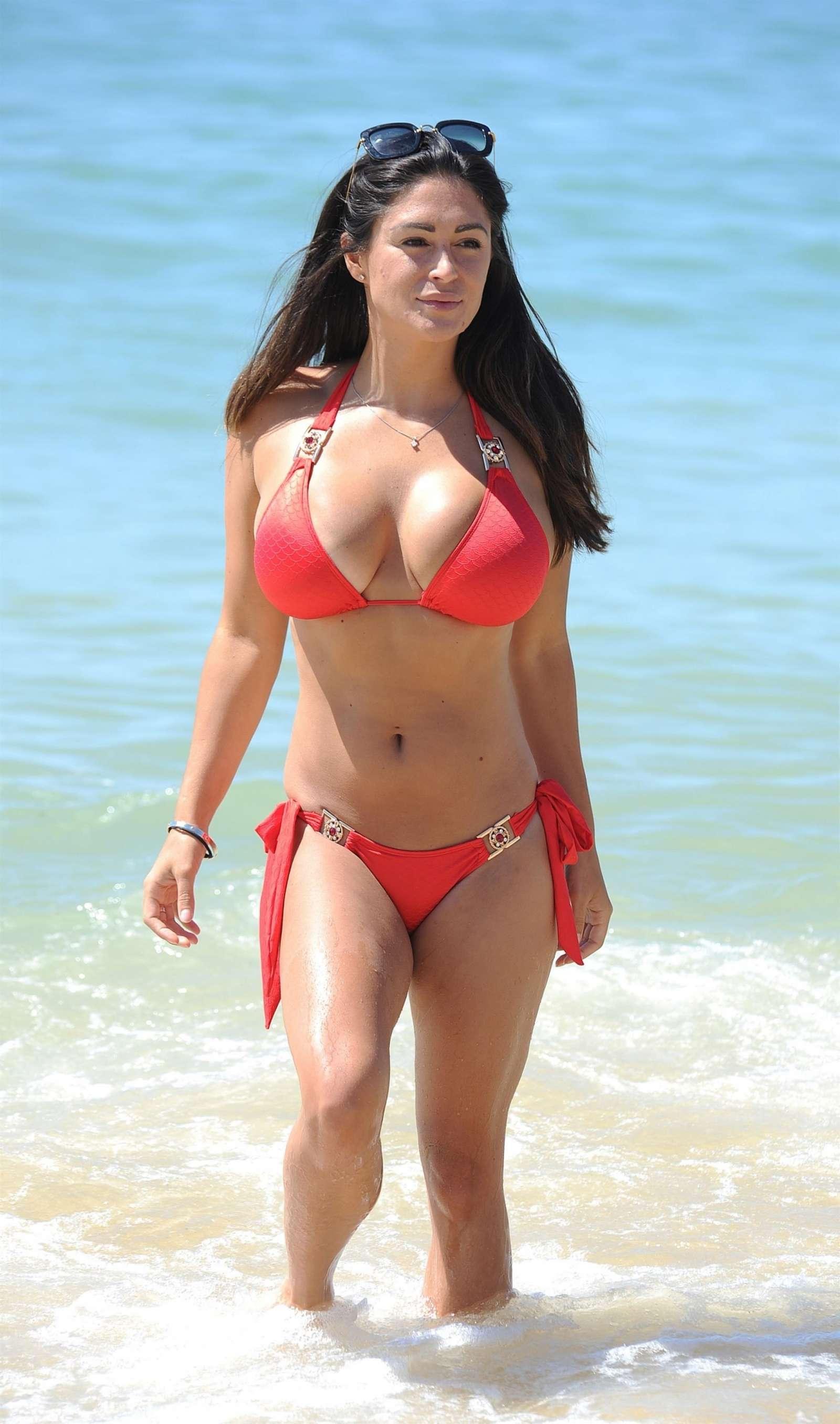 Casey Batchelor in tiny black bikini on the beach in Cyprus Pic 14 of 35