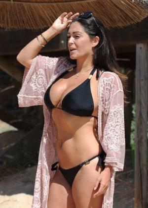 Casey Batchelor in tiny black bikini on the beach in Cyprus