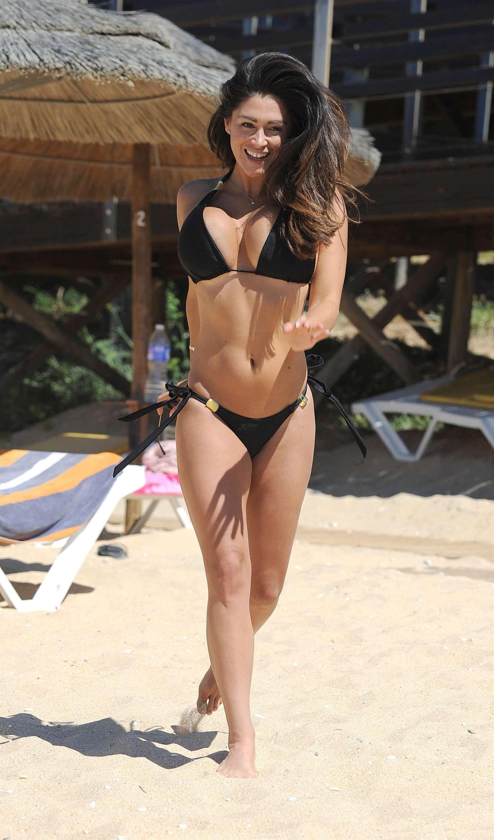 Casey Batchelor in tiny black bikini on the beach in Cyprus Pic 3 of 35
