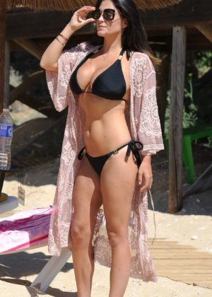 Casey Batchelor in tiny black bikini on the beach in Cyprus Pic 17 of 35