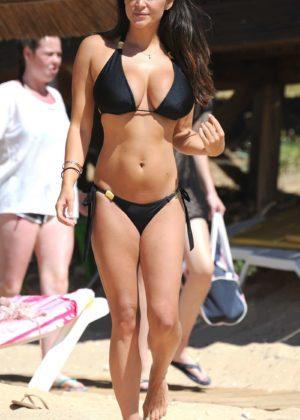 Casey Batchelor in tiny black bikini on the beach in Cyprus Pic 2 of 35