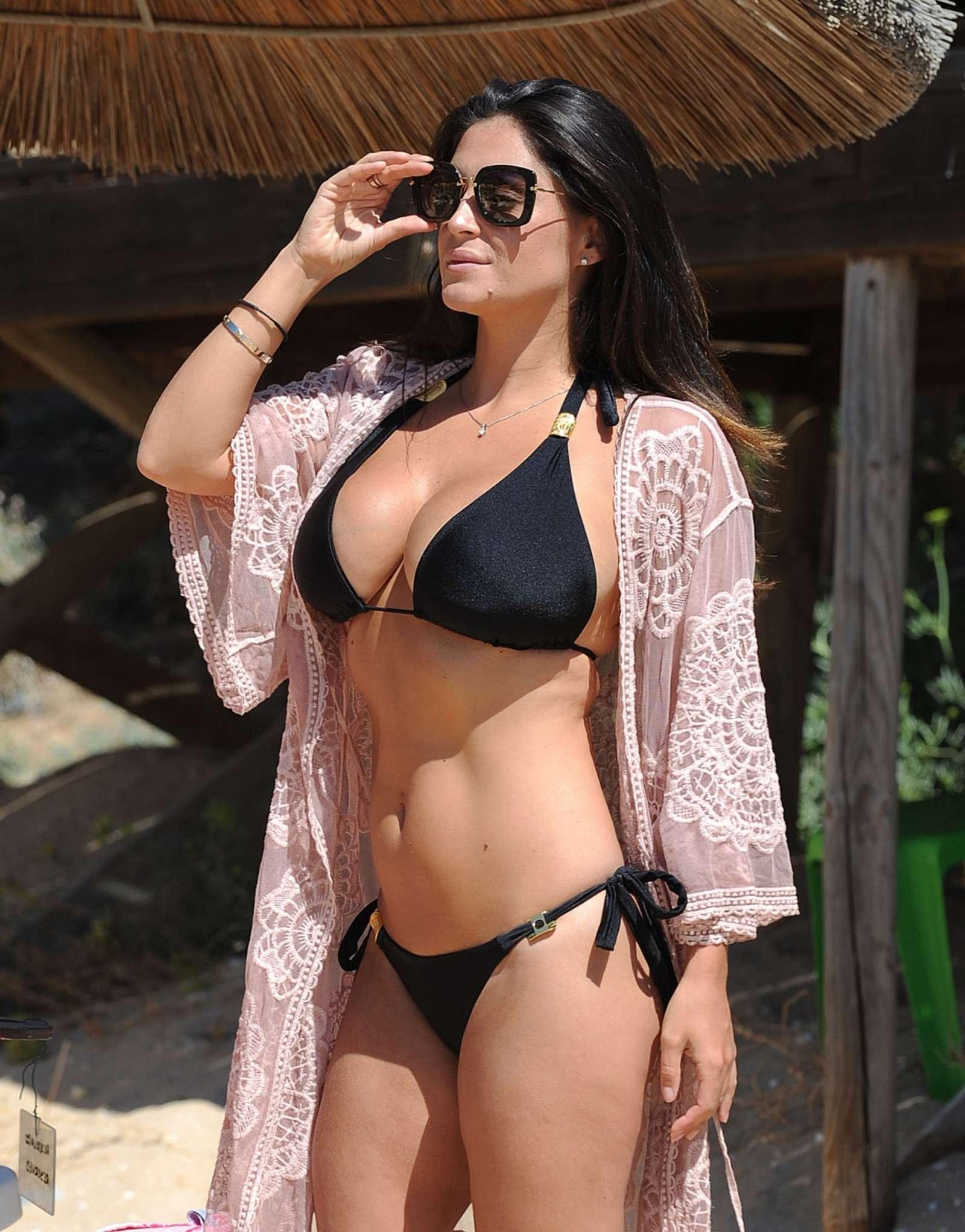 Casey Batchelor in tiny black bikini on the beach in Cyprus Pic 16 of 35