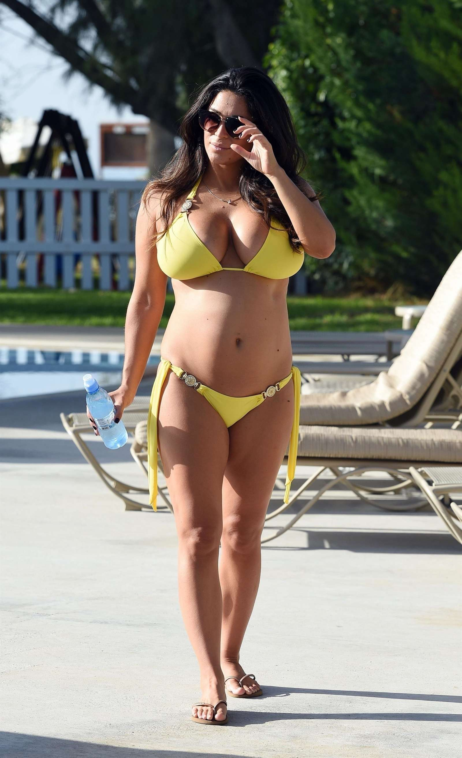 Casey Batchelor in Yellow Bikini at a pool in Cyprus